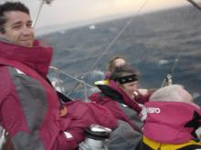 The crew of Sailing for Geeks on board, at sea.