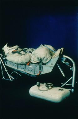 An astronaut sleeping.