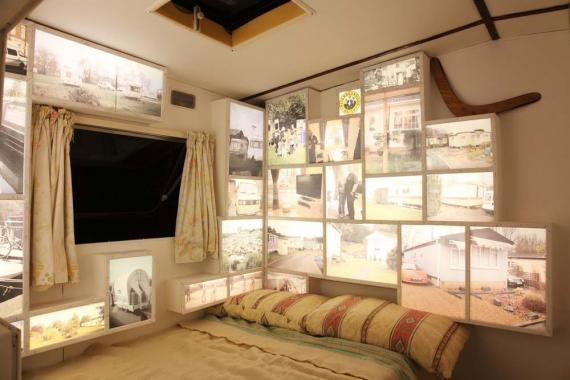 Light box images of mobile homes, installed in a bedroom within a caravan.