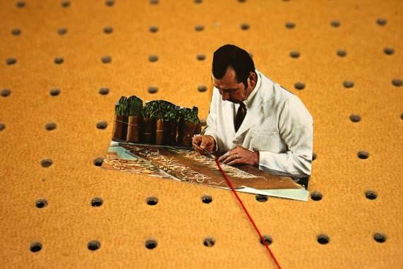 A still from Melanie Jackson's Urpflanze film. A scientist working on a botanical experiment.