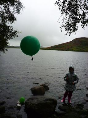 A balloon equipped with GPS technology floats above Loch Ruthven.