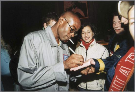 Edward George signs autographs after Cosmonaut Club performance, 2001. Photo: The Arts Catalyst